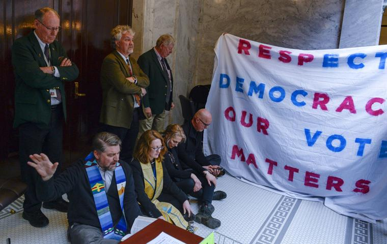 Clergy sit in at state capital wMonica.image
